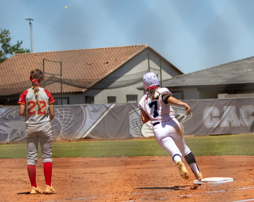 Cactus junior Tanya Windle rounds first base as her home run drops beyond the center field fence during the Cobras 13-0 first-round win over Seton Catholic May 8.