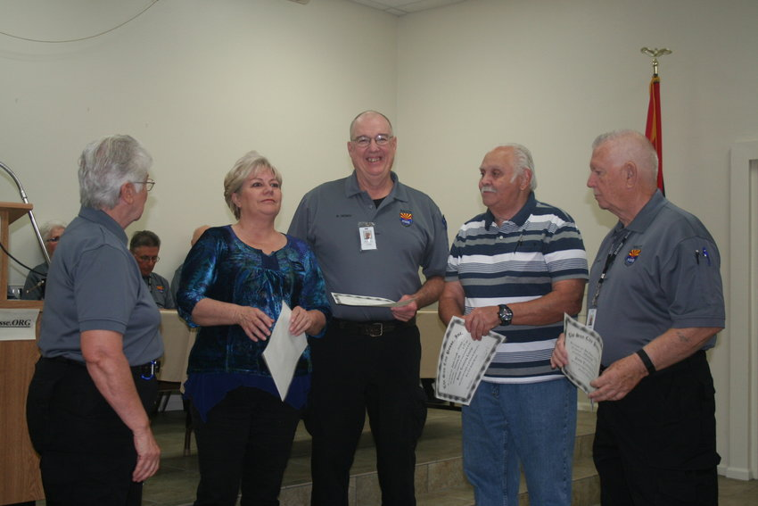 A group of new Posse recruits receive their certificates prior to the COVID-19 pandemic.