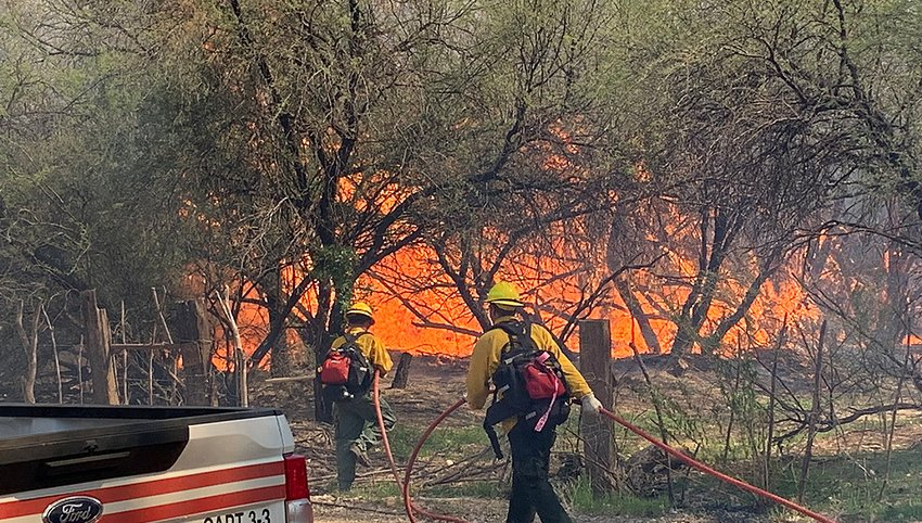 Firefighters prepare to battle a wildfire earlier this year in Arizona. That state recently approved $100 million for those efforts.