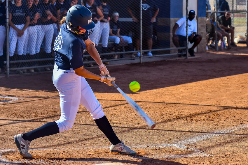 Willow Canyon sophomore Trinnity Kennemer makes contact with a pitch during the Wildcats 5A softball semifinal win over Queen Creek Casteel May 13 at Willow Canyon High School in Surprise.