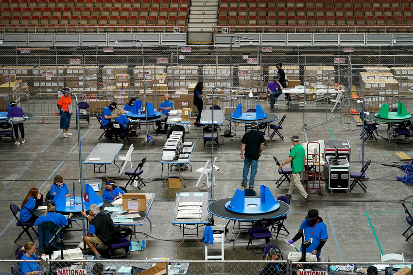 Maricopa County ballots cast in the 2020 general election are examined and recounted by contractors working for Florida-based company, Cyber Ninjas, Thursday, May 6, 2021 at Veterans Memorial Coliseum in Phoenix. [The Associated Press]