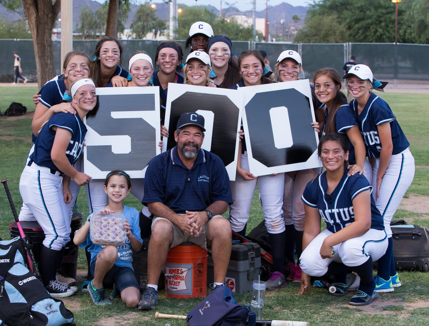 The 2015 Cactus softball team celebrates Cobras coach Bartt Underwood's 500th win (in his time coaching Cactus and Centennial) during the state Division II playoffs at Rose Mofford Sports Complex in Phoenix. Underwood retired this week.