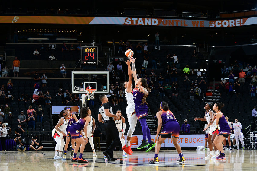 Liz Cambage (8) of the Las Vegas Aces and Brittney Griner (42) of the Mercury jump for the tip at the start of Wednesday's game Phoenix Suns Arena. The Aces beat the Mercury 85-79. [Photo by Michael Gonzales/NBAE via Getty Images]