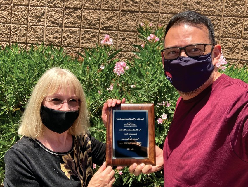 Becky Sayler, League of Women Voters of Northwest Maricopa County, presented the Guardian of Our Democracy Award to former Maricopa County Recorder Adrian Fontes.