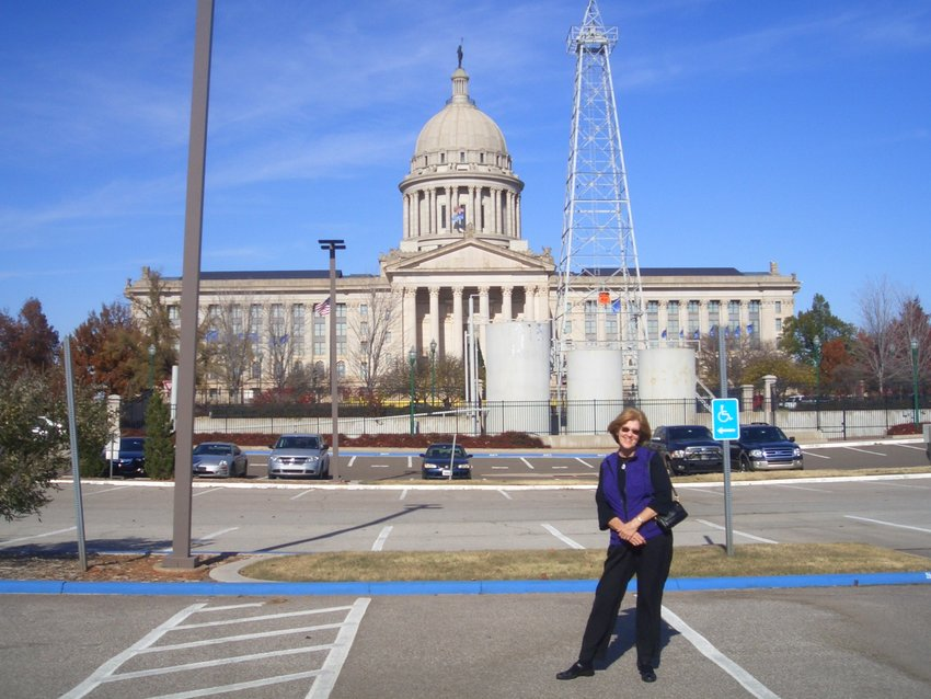Peggy Kirschner poses in front of the Oklahoma State Capitol.