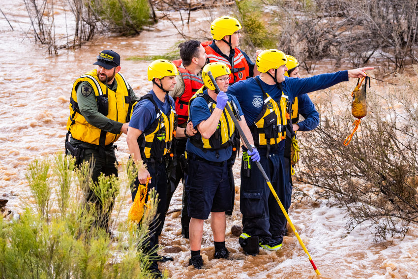 Pinal County Sheriff's Office officials and others at a water rescue in a flooded area.