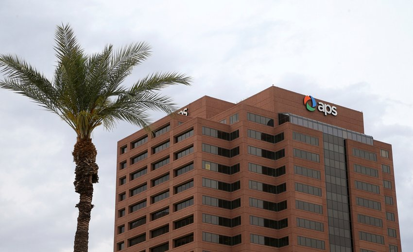 This Tuesday, April 16, 2019 file photo shows a view of the Arizona Public Service Co. utility in Phoenix. APS, the state's largest utility, is warning customers of scammers as temperatures soar and reliance on air conditioning increases.