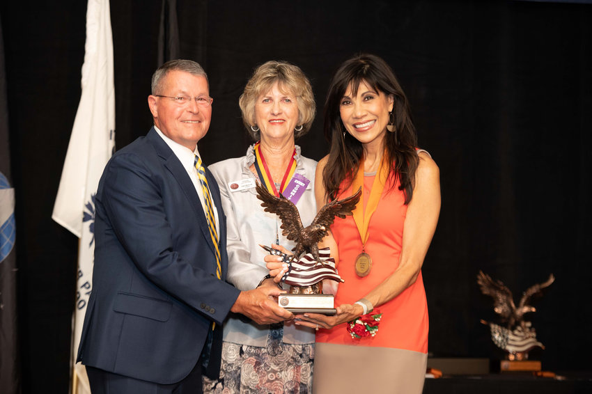 Hospice of the Valley veteran volunteer Denny Bash of Surprise, left, and Community Engagement Director Lin Sue Cooney, right, with event co-chair Pat Upah. Bash and Cooney accepted the Copper Eagle Award on behalf of the nonprofit agency.
