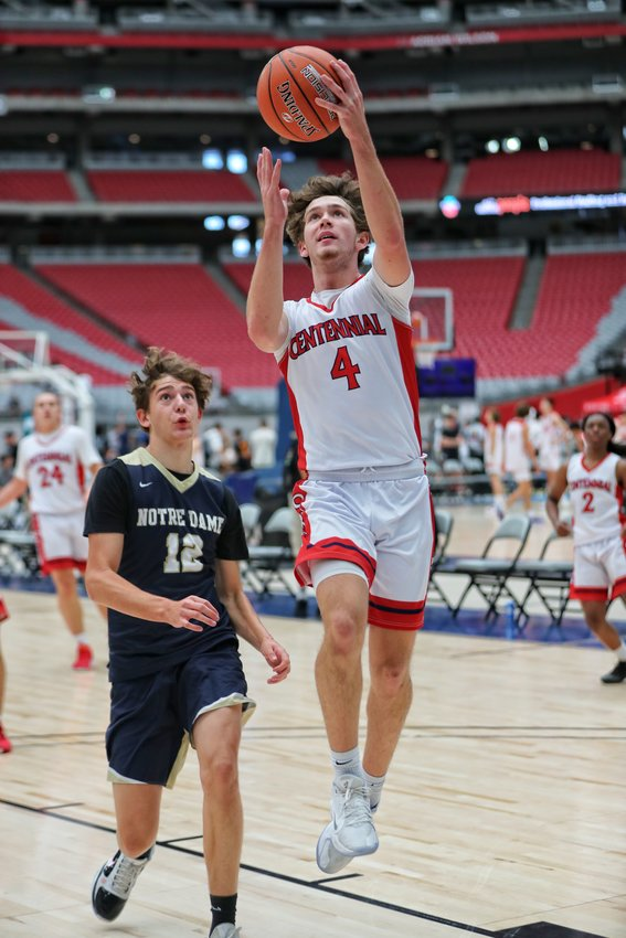 Jake Lifgren, who will be a senior at Centennial High School in August, goes up for a layup against Sherman Oaks (Calif.) Notre Dame during a game at the Section 7 Team Camp on June 20 at State Farm Stadium in Glendale.
