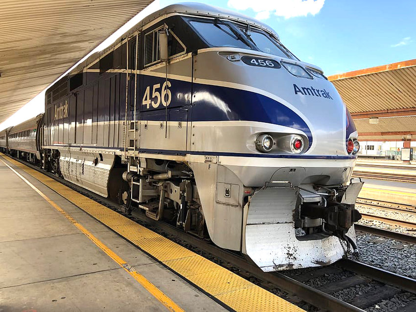 An Amtrak passenger train is stopped at a station in Tucson. Arizona government and business leaders joined Amtrak officials in a virtual roundtable Tuesday encouraging Congress to fund a new passenger rail line connecting Phoenix to Tucson. [Submitted photo/Creative Commons]