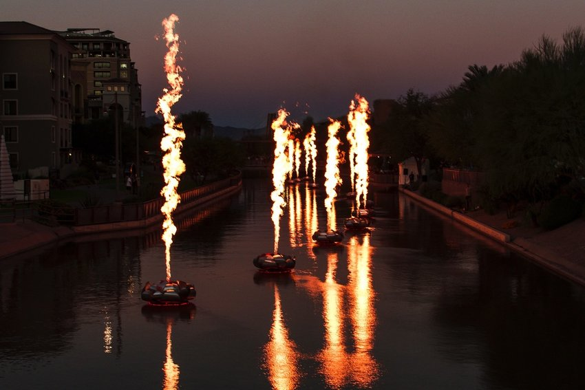 """""""Floatus"""" by Walter Productions presents a fire show during Canal Convergence 2018 at the Scottsdale Waterfront."""