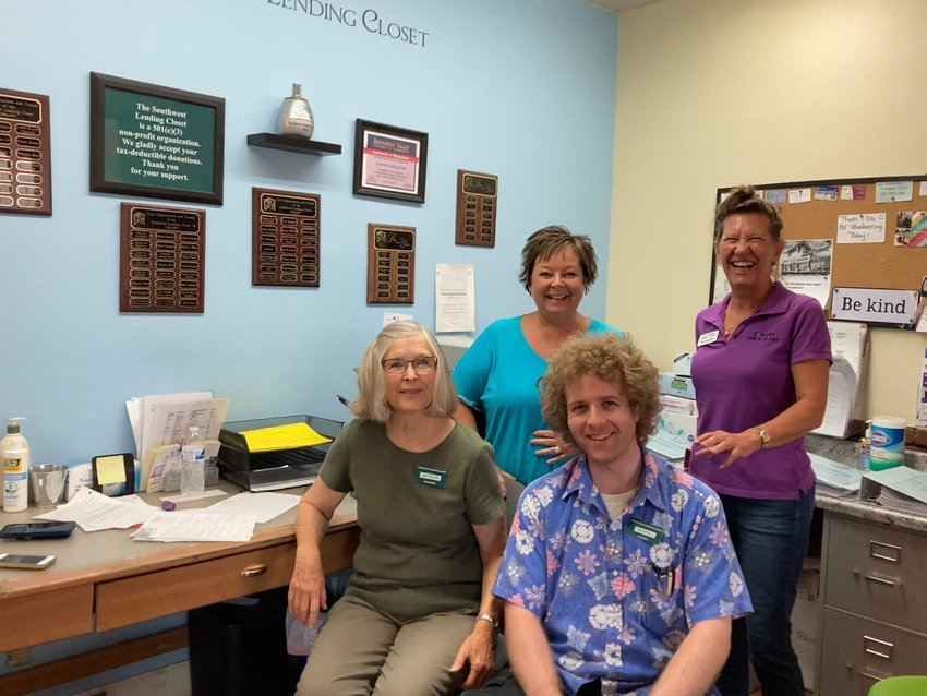 Southwest Lending Closet Executive Director Ann DeVlaeminck (back right) poses with a group of volunteers at the Closet's location in Avondale.