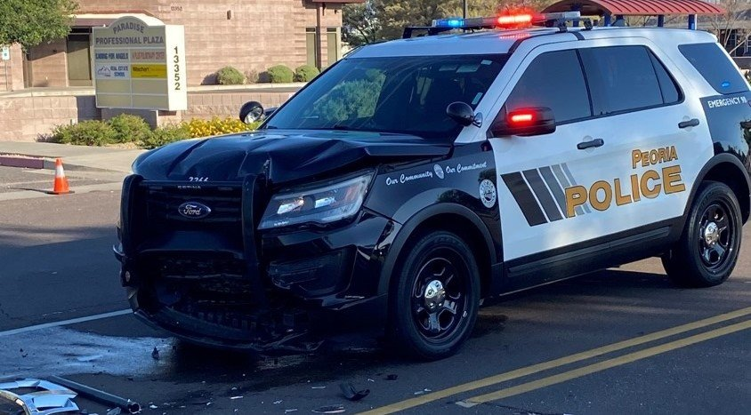 A Peoria police officer was  injured after a head-on collision on 83rd Avenue, Aug. 3.