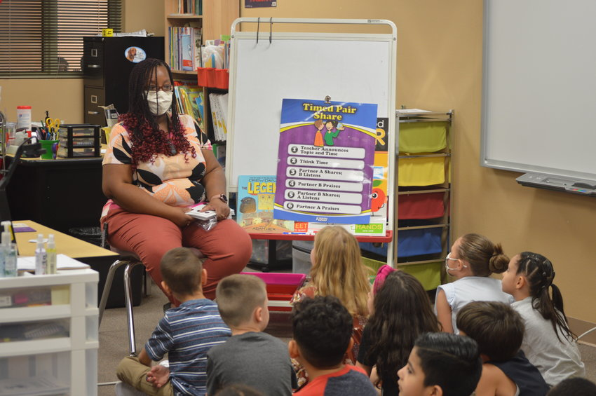 First week of school: First graders circle around Ms. Shalawna Howard at Barbara B. Robey Elementary School in Litchfield Park, part of the Litchfield Elementary School District.
