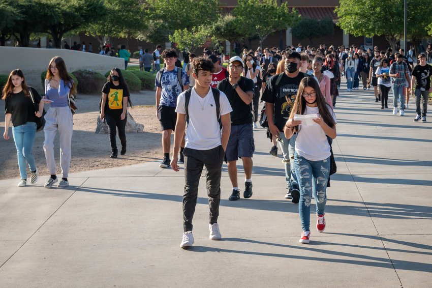 Dysart High School students stream onto the school's El Mirage campus on Aug. 3, the first day of class.