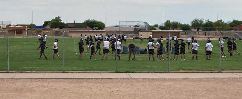 Apache Junction High School football players at a practice.