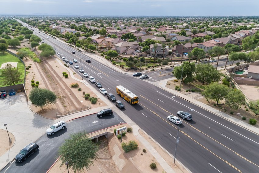 This is an aerial view of the line of cars that builds up during the morning hours for student drop-off at West Point Elementary School, 13700 W. Greenway Road.