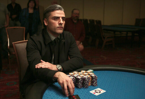 """This image released by Focus Features shows Oscar Isaac in a scene from """"The Card Counter."""" (Focus Features via AP)"""