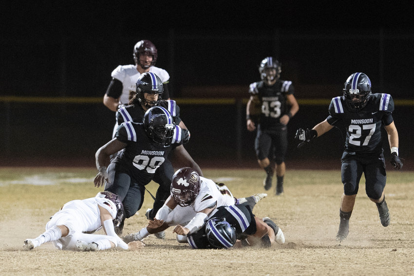 Valley Vista junior defensive end Jaelin McCullen (#99) and his teammates look to fall on a fumble during the Monsoon's Nov. 20, 2020 home game against Shadow Ridge. McCullen returns for her senior season.