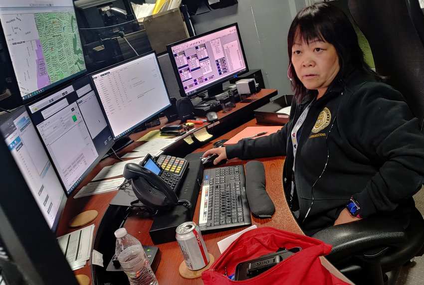 Carrol Simmons takes a 911 call at around 2:30 a.m. at the Glendale Regional Public Safety Training Center, at 115th and Glendale avenues, on Aug. 24.