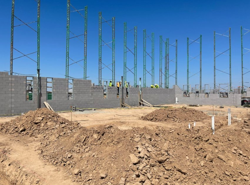 The walls are going up at what will become the Queen Creek Unified School District's new high school. The school is set to open on July 2022.