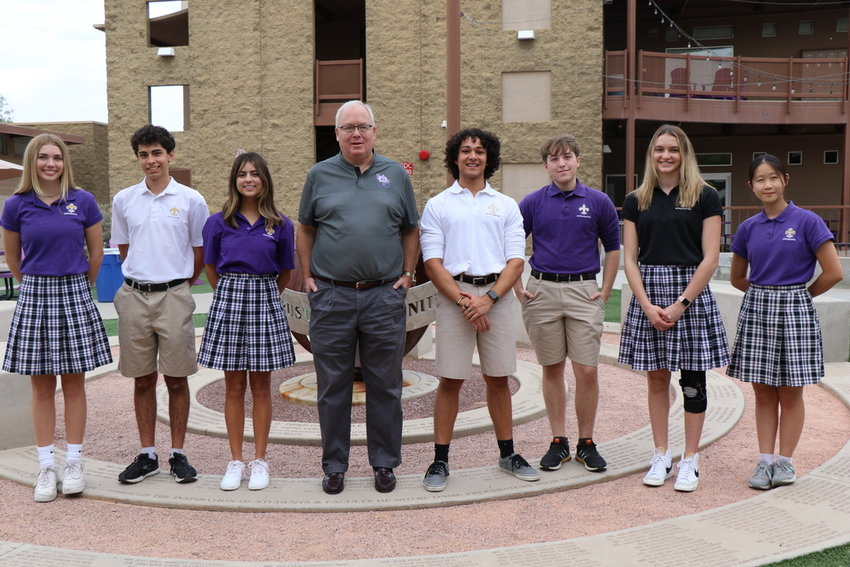 From left, Notre Dame Prep students, Keira Ryan, Alejandro Heredia, Sophia Barlo, Gene Sweeney, Carlo Lanza, Jacob Wetherell, Madison White and Radia Wong pose with NDP Principal Dr. Gene Sweeney after earning national academic honors recognition.