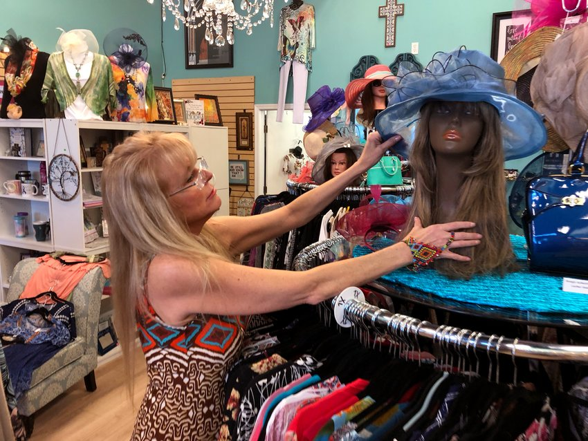 Linda Donner, manager of Son Glow Boutique, 11294 W. Bell Road No. 105, straightens up a display inside the store. The non-profit business was voted the top local favorite retailer in the 2021 Surprise Retail Survey. At the Sept. 7 City Council work session, Economic Development Director Jeanine Jerkovic cited the survey as a helpful tool to get favorite small businesses exposure.
