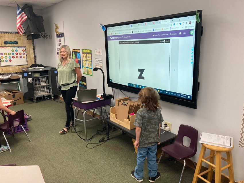 Interactive boards, like in Peralta Trail Elementary School teacher Erika Longacre's class, are replacing older Smart Boards at Apache Junction Unified School District schools.