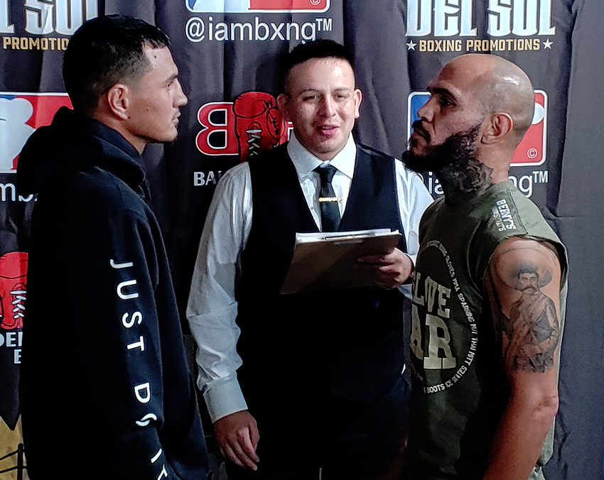 Former WBO lightweight champion Ray Beltrán, right, sizes up opponent Edgar Ramirez during Thursday's weigh-in at Mariscos y Sushi El Dorado Sin III in Glendale for the Brawl in the Barrio's main event.