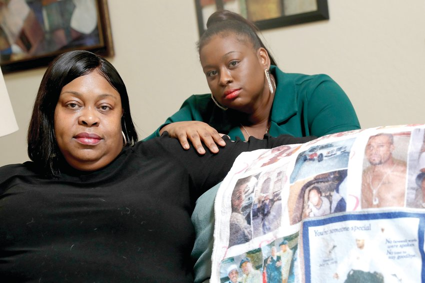 Mussallina Muhaymin, left, and Zarinah Tavares, sisters of Muhammad Abdul Muhaymin Jr., a homeless man who died while in Phoenix police custody, pose for a photo on June 5, 2020 in Phoenix. The city of Phoenix is creating a victim advocacy office for victims who experienced a traumatic incident involving Phoenix Police, including in-custody deaths, being shot by police or police use of force that resulted in death or serious injury. [Matt York/The Associated Press]