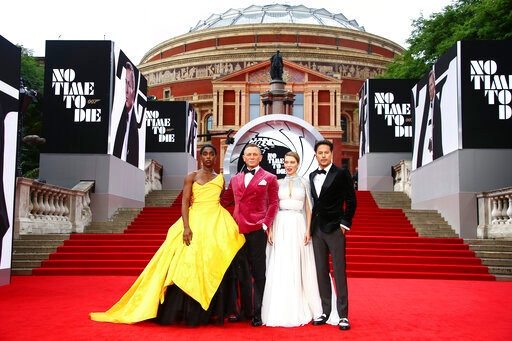 Lashana Lynch, from left, Daniel Craig, Lea Seydoux and Cary Joji Fukunaga pose for photographers upon arrival for the World premiere of the new film from the James Bond franchise 'No Time To Die', in London Tuesday, Sept. 28, 2021. (Photo by Joel C Ryan/Invision/AP)