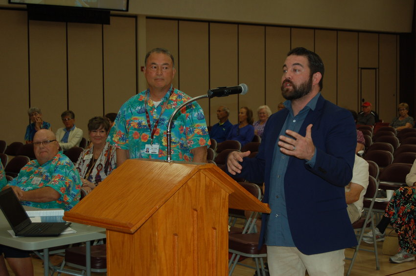 Bill Cook, Recreation Centers of Sun City general manager, left, and Jake Connors, security consultant, make a presentation outlining planned security measures for RCSC facilities.