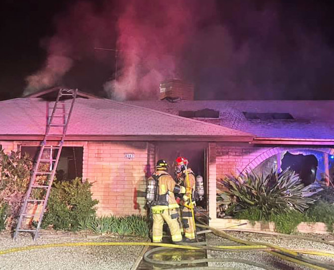 Firefighters from Glendale and Phoenix Fire Department fought a house fire near 45th Avenue and Echo Lane Monday night in Glendale.