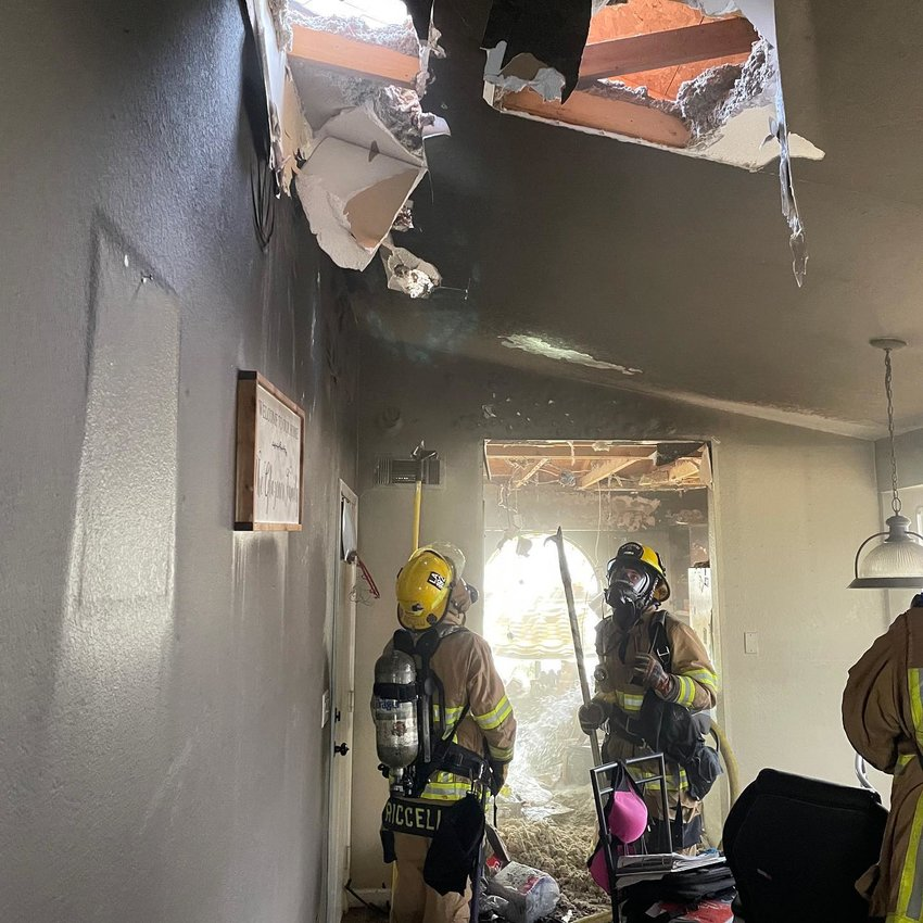 Firefighters assess the rubble of a recent kitchen fire in Peoria that spread to the attic of a home. Firefighters are members of the Arizona Public Safety Personnel Retirement System, which provides retirement benefits and programs to active members, retired members and surviving beneficiaries. The system as a whole is under funded by 52%. The Peoria Fire-Medical Department is under funded by 34% and the Peoria Police Department is under funded by 45%.