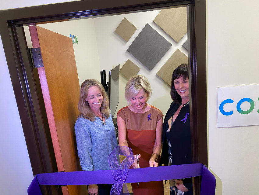 Susan Anable from Cox Communications, and Cathy Kleeman and Kim McWaters from Fresh Start Women's Foundation officially open the virtual courtroom for use.