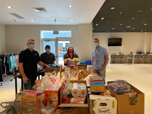 A team from TruWest Credit Union dropped donated items off at Mesa Community College.