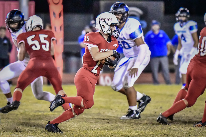 Dysart's Dominic Robinson looks for room to run against Paradise Honors Friday night in El Mirage.