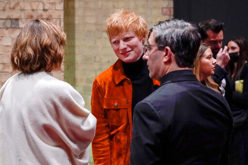 FILE - In this Sunday, Oct. 17, 2021 file photo, British singer Ed Sheeran attends the first ever Earthshot Prize Awards Ceremony at Alexandra Palace in London. On Sunday, Oct. 24, 2021, Sheeran said he has tested positive for COVID-19 and will do interviews and performances from his house while he self-isolates. (AP Photo/Alberto Pezzali, Pool)