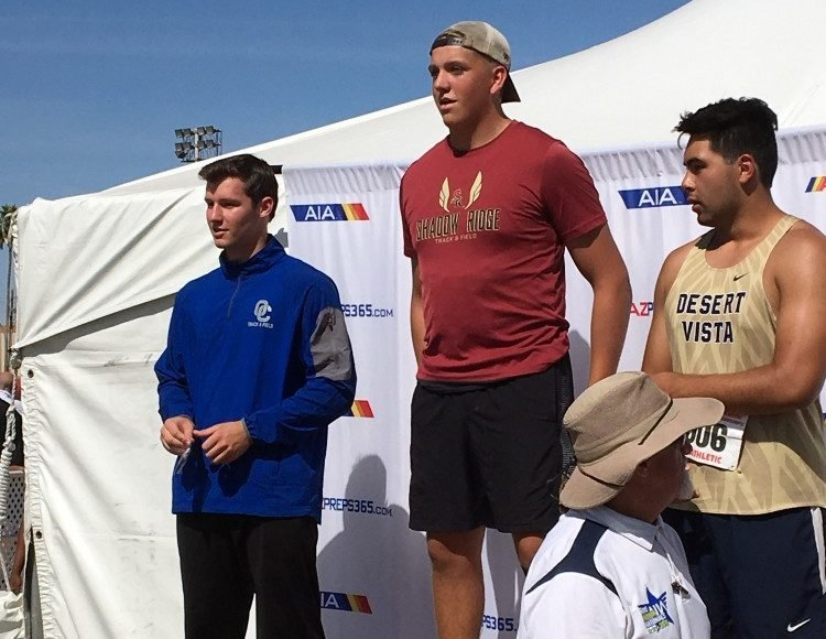 Shadow Ridge junior Joshua Scott, center, stands atop the podium on May 4, 2019 at Mesa Community College after winning the state Division I discus title. He is flanked by third-place Ethan Jezulin of O'Connor, left, and second-place Jorden Morales of Desert Vista.