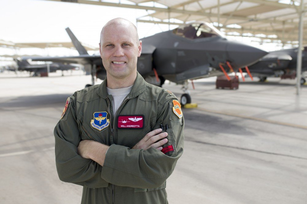 USAF Maj. Will Andreotta poses for a photograph beside an F-35 fighter jet on Wednesday, Aug. 15, 2018 at Luke Air Force Base in Glendale. [Jacob Stanek/Independent Newsmedia]
