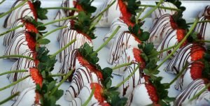 White chocolate covered strawberries sit on display during a past Chocolate Affaire event in downtown Glendale. [Independent Newsmedia file]