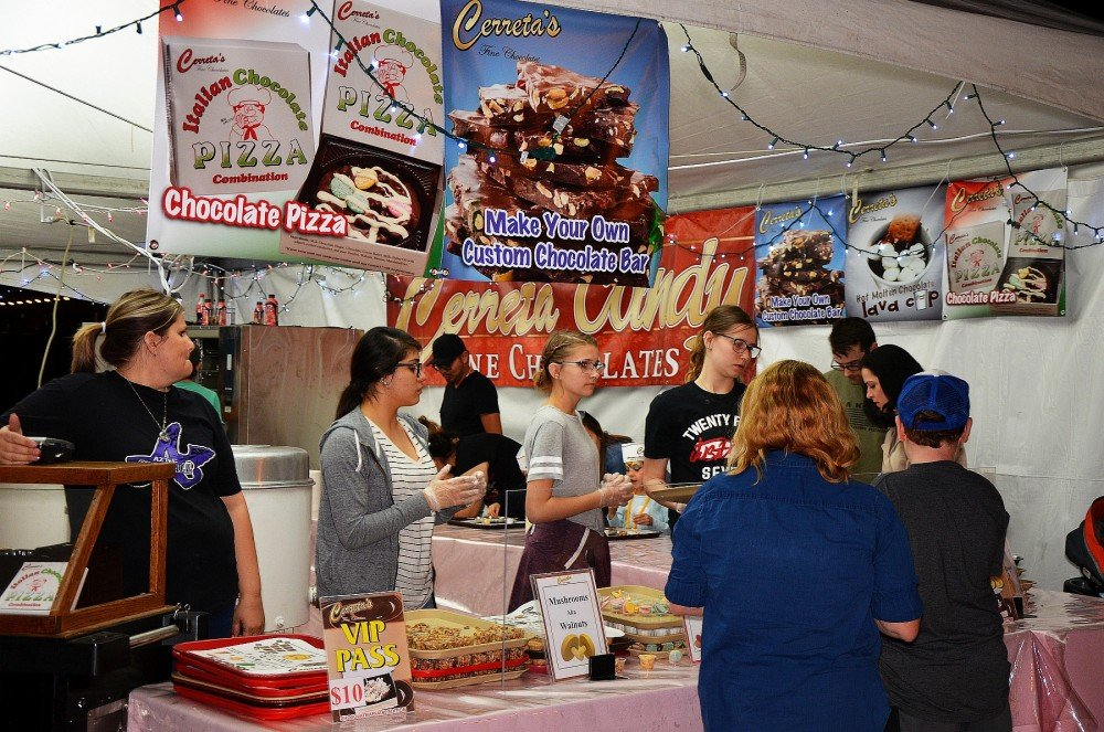 Glendale residents and visitors visit the Cerreta Candy Company booth during a past Chocolate Affaire event in downtown Glendale. [Independent Newsmedia file]