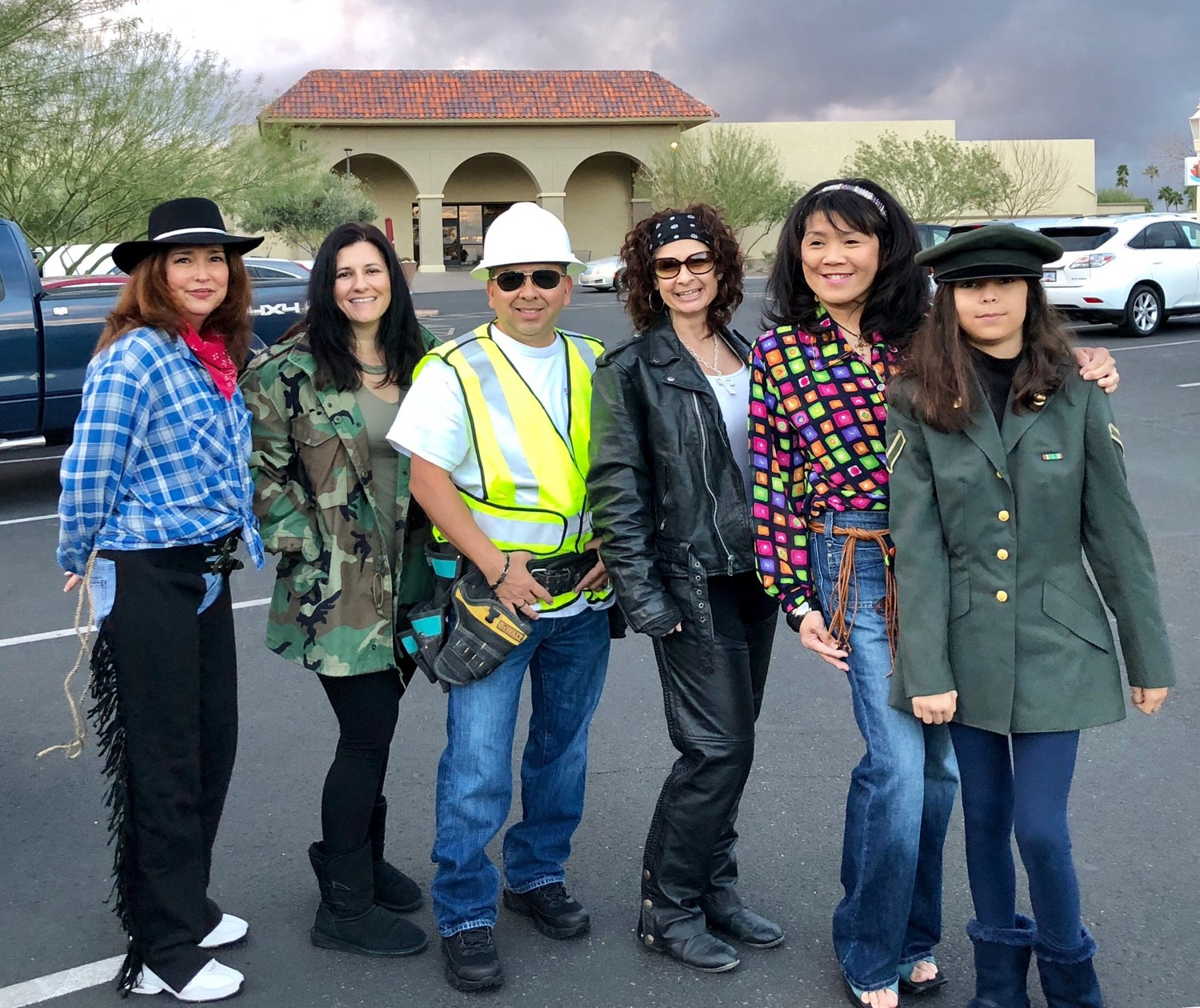The team enjoys participating in community events, including dressing up in different themes for parades. This 50th anniversary parade in Sun City West celebrated the seventies. Independent Newsmedia first bought newspapers in Arizona in 1977.