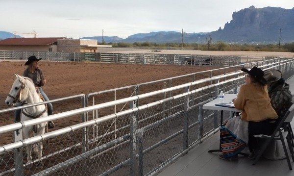 At left, Paris Carlyon speaks to the judges at the horsemanship portion of the competition for 2019 Lost Dutchman Days queen.