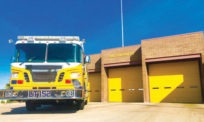 The Glendale Fire Department put the finishing touches on the yellow bay doors at Fire Station 152 to match their fire trucks. [Submitted photo]