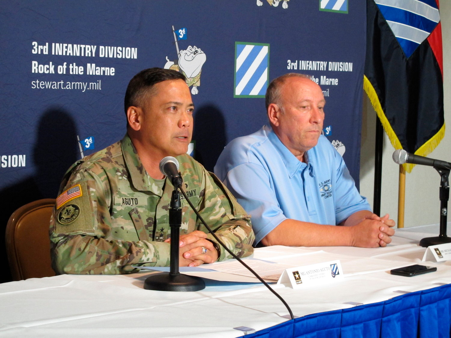 Army Maj. Gen. Antonio Aguto, left, and Army accident investigator Michael Barksdale hold a news conference, Monday, Oct. 21, 2019, at Fort Stewart, Georgia, about a training accident that killed three soldiers and injured three others.