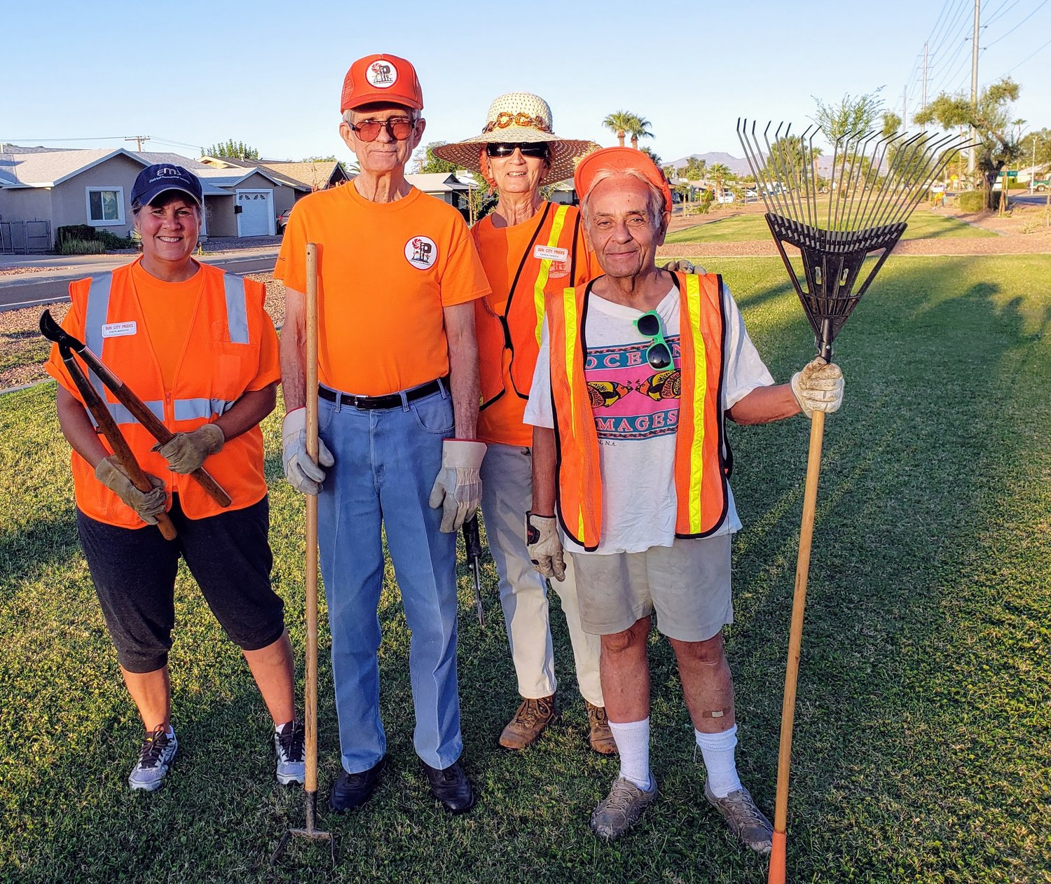 Sun City PRIDES volunteers working on Alabama Avenue, from left, Cheri Marchio, Bruce Calhoun, Karen Harper and Alan Rockman.