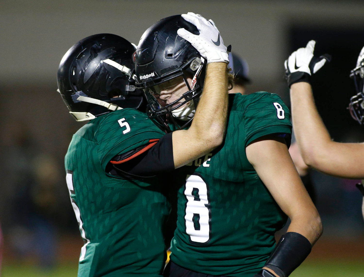 Mountain Ridge senior wide receiver Kyler Stancato (8) is congratulated by teammate Cole Mitchell after catching a touchdown pass against Sandra Day O'Connor during the first half of their 6A football game on Friday, Nov. 1.