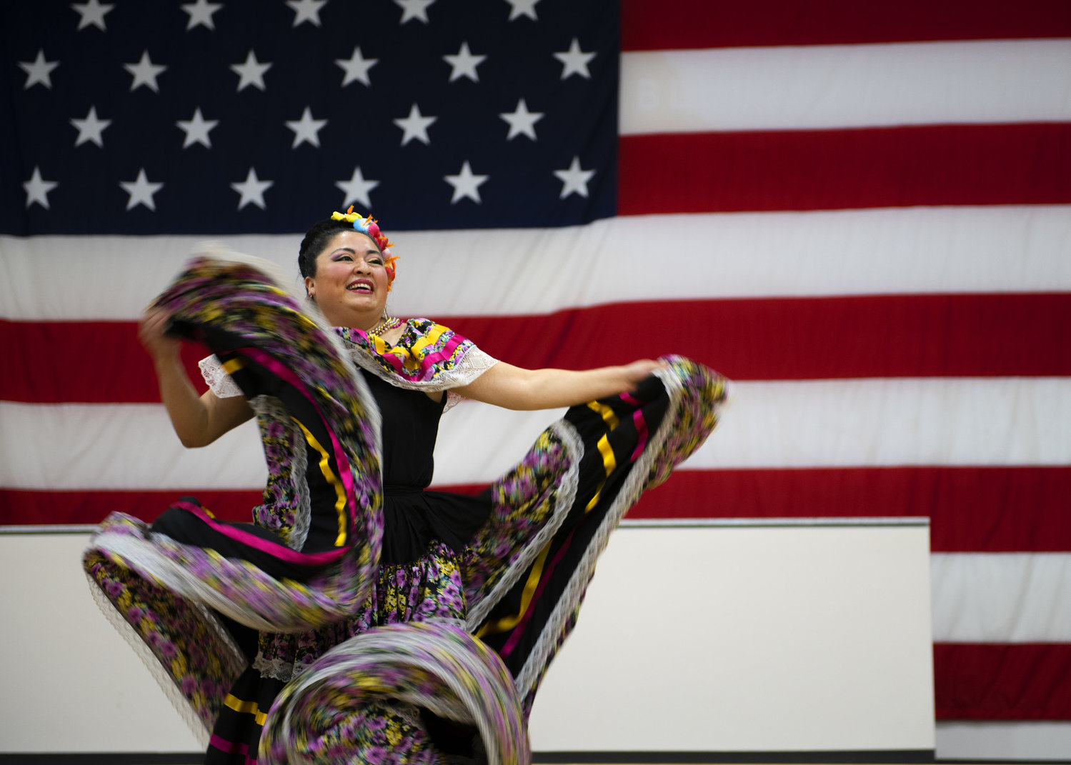 A member of the Ollin Yoliztli Mexican Folklore Dance Academy performs a traditional dance during the Hispanic Heritage Month closing ceremony at the Navy Operational Support Center, Oct. 15 at Luke Air Force Base in Glendale. Luke AFB observed HHM Sept. 15 to Oct. 15 to recognize the contributions of Latin people in society and provide education about their culture. [U.S. Air Force photo by Airman 1st Class Leala Marquez]