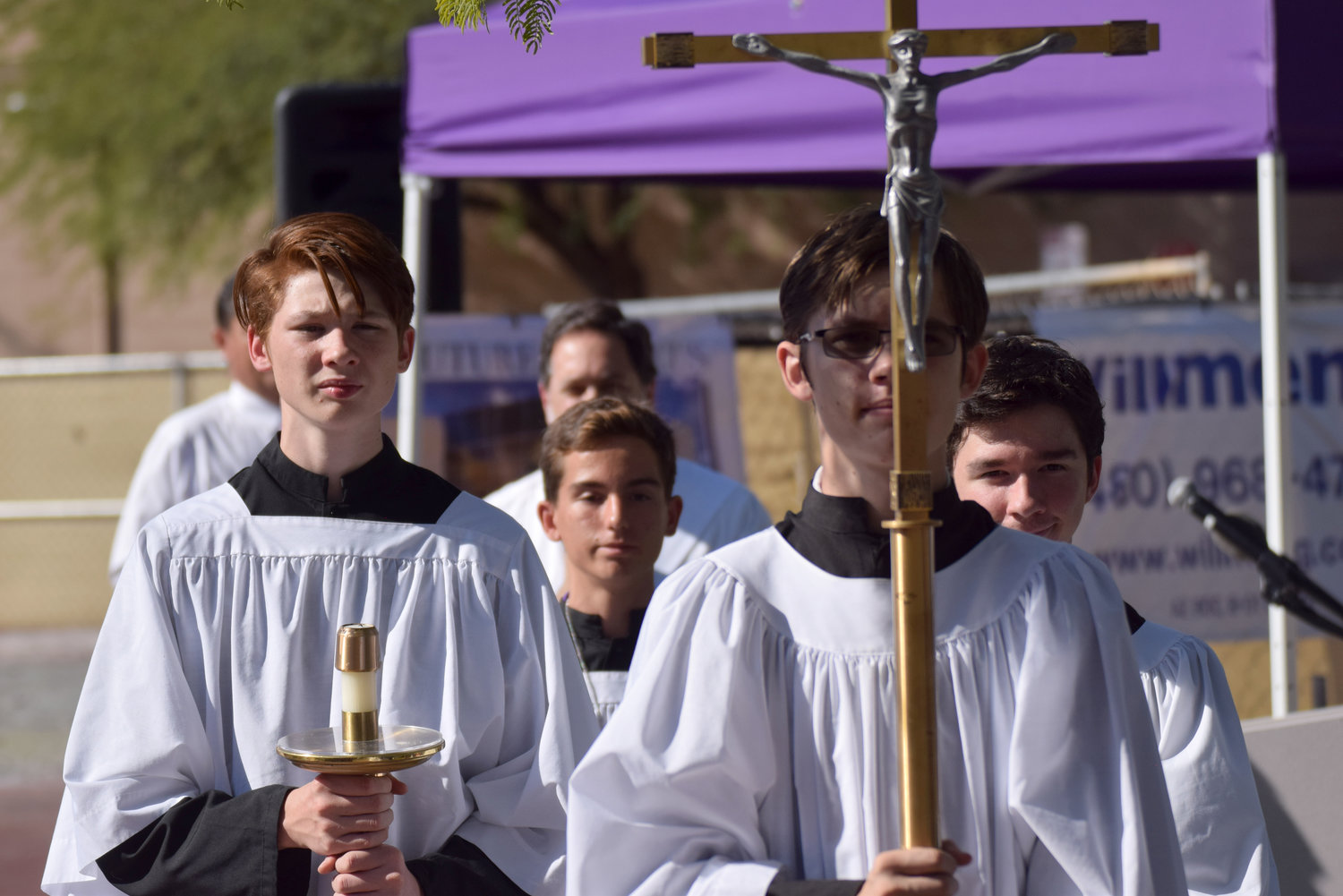 The cross bearer carries the crucifix after the Nov. 5 groundbreaking ceremony for NDP's new performing arts center.